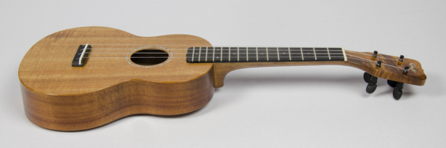 David Dart Koa Concert Ukulele, Style 1 (2016): curly koa top; one-piece koa back; koa neck; ebony fingerboard & bridge; abalone Dart logo (hand-cut), soundhole inlay (hand-cut), & fingerboard dots