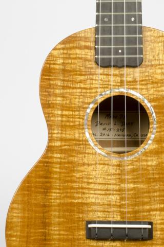 David Dart Koa Concert Ukulele, Style 1 (2016): curly koa top; one-piece koa back; koa neck; ebony fingerboard & bridge; abalone Dart logo (hand-cut), soundhole inlay (hand-cut), & fingerboard dots